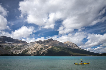 Kyaking on clear blue lake Banff Alberta