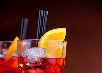 Fototapete - glasses of spritz aperitif aperol cocktail with orange