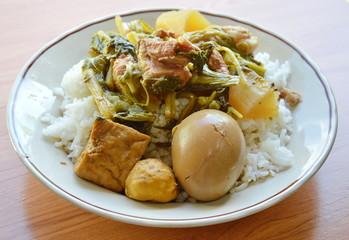 egg boiled brown sauce and boiled vegetable with pork rib