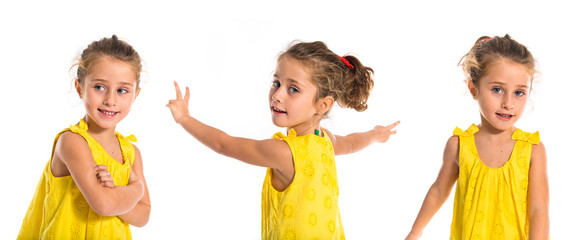 Blonde little girl dancing over white background
