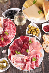 composition with meat, heese and wineglass