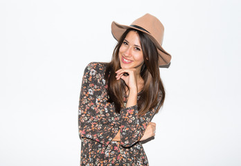 Cute woman with hat in studio