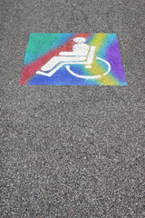 Colored symbol of the handicapped person painted on the asphalt