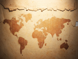world map displayed on the corrugated old paper