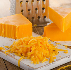 Grated Cheddar Cheese on  Cutting Board.