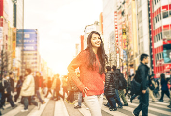 young girl walking on the streets of tokyo
