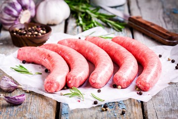 raw homemade sausages on a paper