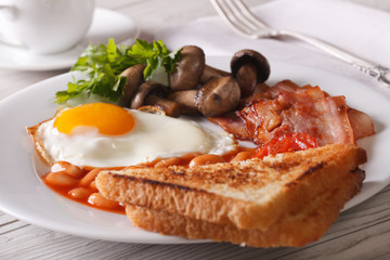 English breakfast: fried eggs with bacon and vegetables