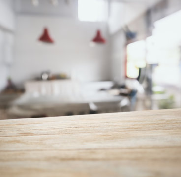 Wooden table top counter bar with blurred kitchen background
