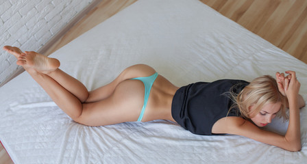 young woman ass with  lingerie on white bed