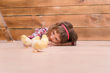 Girl lying on floor and watching for chickens