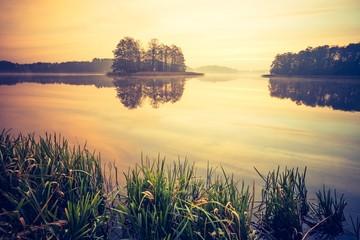 Vintage photo of sunset lake