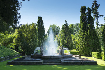 Papiers peints Fontaine Fountain and meadow at the park in spring season
