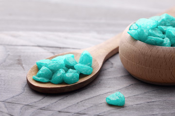 Spa concept. Blue salt and spoon on wooden background.