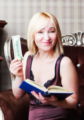 The woman found the money in the book