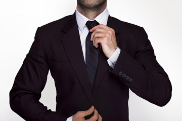 Businessman adjusting his suit and tie
