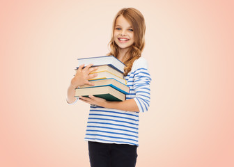 happy little student girl with many books