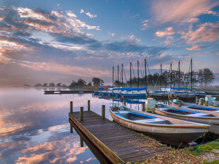 Wall Mural - recreational harbor at a sunrise lake
