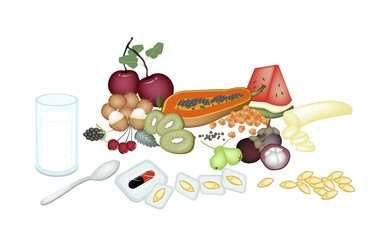 Fruits with Vitamine Capsules on White Background
