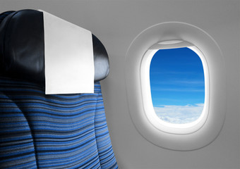 Blue seat beside window plane