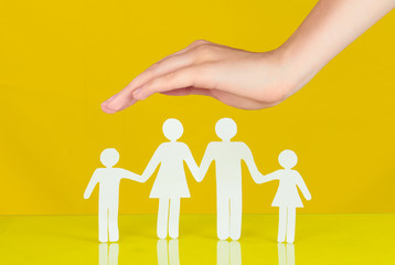 Protection gesture  isolated on yellow background.Family life insurance, protecting family, family concepts.
