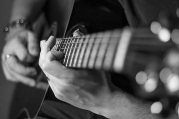 playing guitar at home