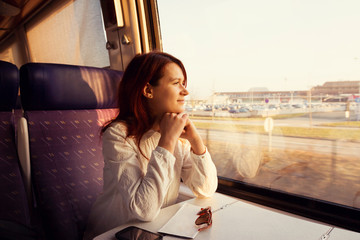 Smiling woman traveling by train.Travel Comfort