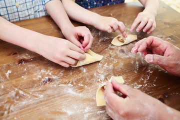 Cooking together with children manti (Central Asia dumplings)