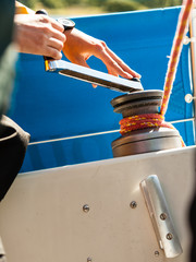 Winch capstan with rope on sailing boat.