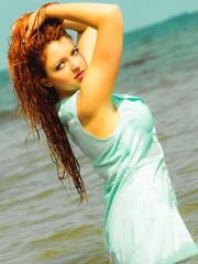 Vacation. Girl in water having fun on the sea.