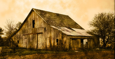 Old farm barn in sepia