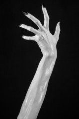 white hands of death with black nails, white death, white skin