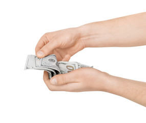 Hands holding american dollar bills. Isolated on a white backgro