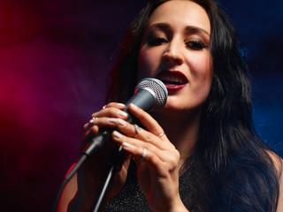 Beautiful woman sings