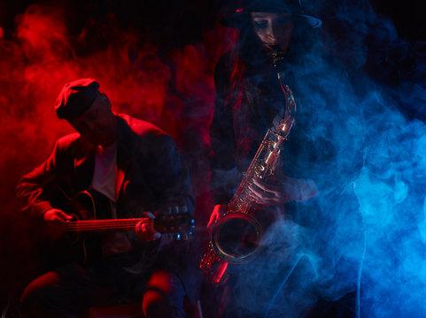 Beautiful young woman plays saxophone