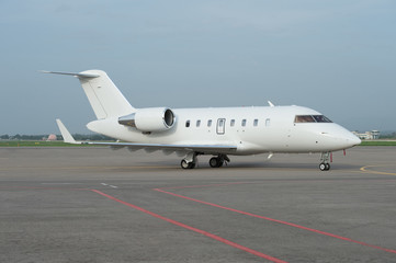 Business jet airplane on the ground