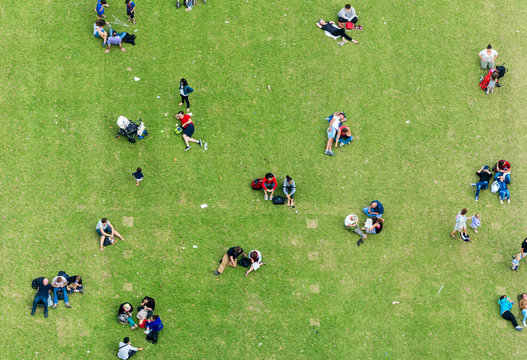 Ninety degrees view of people relaxing on a meadow
