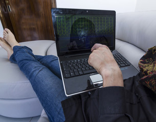 hacker with computer cyber crime laptop