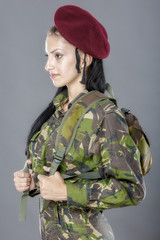 portrait of a woman soldier with backpack