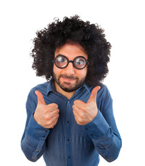 Man with crazy expression and thumb up