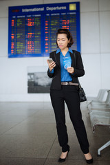 Business lady with boarding pass