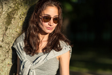 beautiful girl in sunglasses in the park