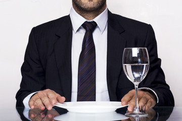 Businessman dinning with a glass of water
