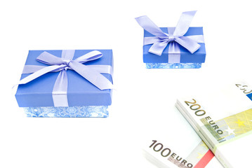 two blue gift boxes and banknotes