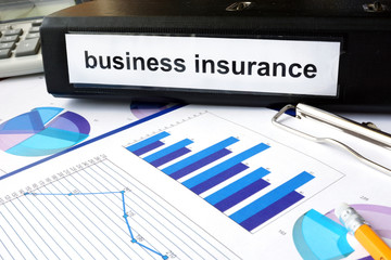 Folder with the label business insurance and charts