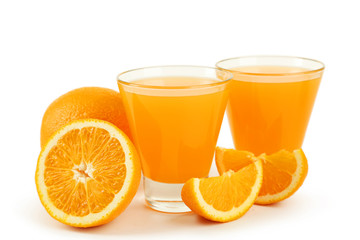 Glass of fresh orange juice on wooden background