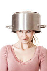 Disappointed funny girl portrait wearing soup pot as hat