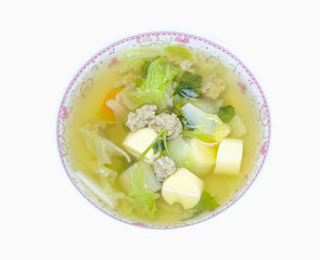 clear soup with bean curd and minced pork in dish on white backg