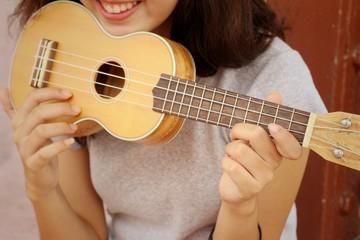 Woman playing ukulele, vintage style