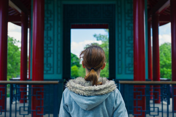 Woman by pagoda in park